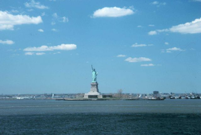 The Statue of Liberty, New York Harbor, with fair weather cumulus Picture