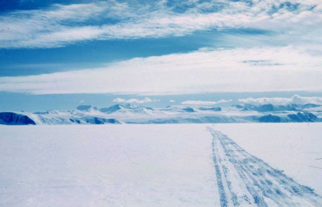 Looking back at the trail as the expedition leaves the Trans- Antarctic Mountains on the last 300 miles to the South Pole Picture