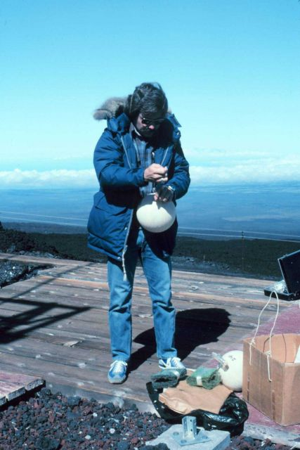 Using an evacuated glass flask to collect air sample to be analyzed for carbon dioxide Picture