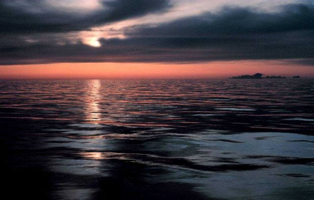 Sunset over a calm ocean Picture
