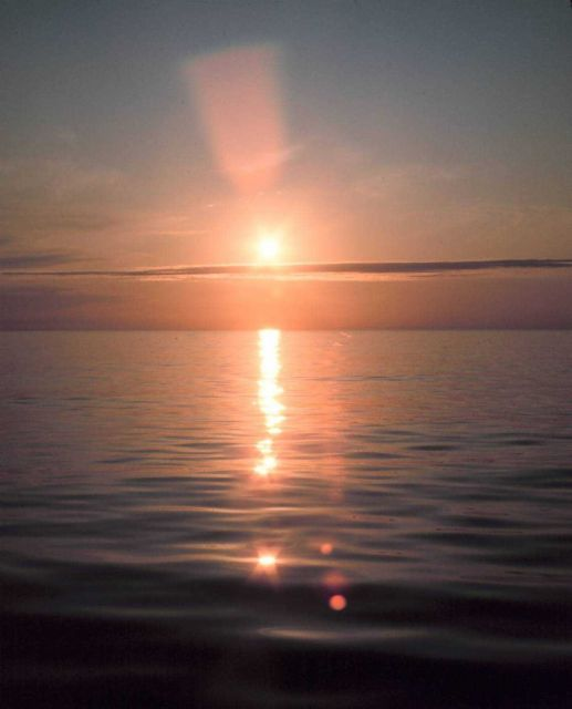 Brilliant reflection of sunlight off a calm ocean. Picture