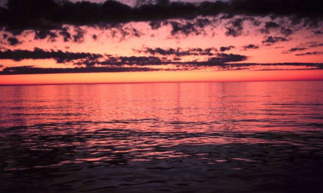 Red sky above reflecting off a red sea below. Picture