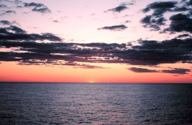The last of the upper limb of the sun just before diving below the horizon. Picture