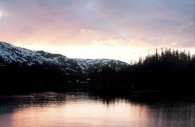 Sunset illuminating a quiet cove in Southeast Alaska. Picture