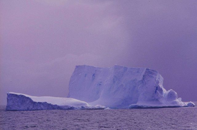 Iceberg with a sprinkling of penguins. Picture