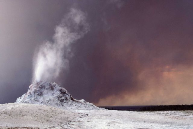 Steam phase of Castle Geyser with black smokey skies Picture