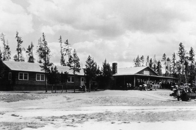 People and buses at Old Faithful Lodge Picture