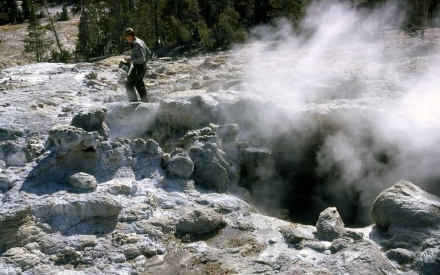 Ranger at Steamboat Geyser (note camera) Picture