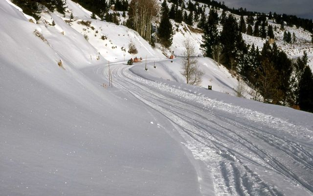 Snowmobilers approaching the Hoodoos Picture