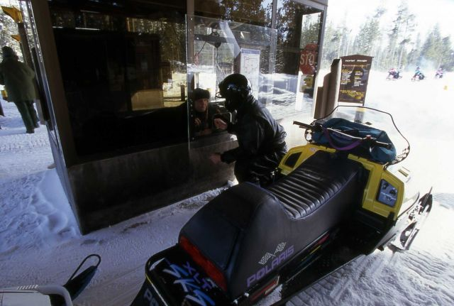 Snowmobile at the West Yellowstone entrance station Picture