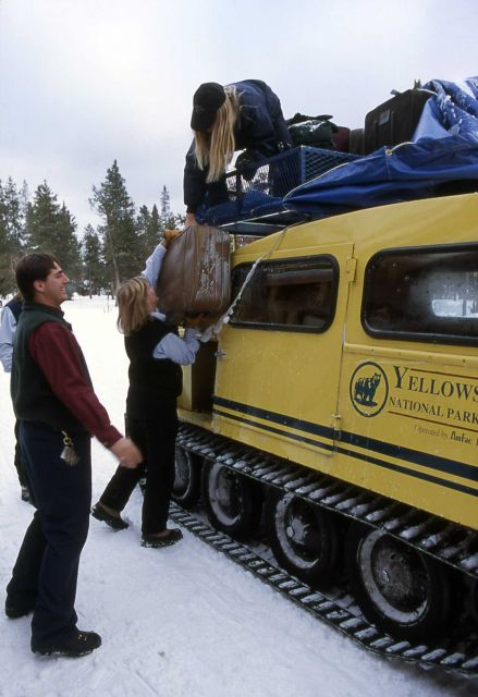 Bellman & snowcoach drivers unloading at Old Faithful Snow Lodge Picture