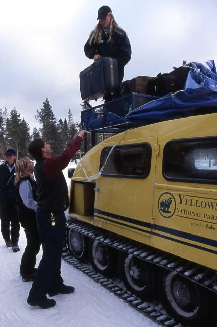 Bellman & snowcoach drivers unloading snowcoach at Old Faithful Snow Lodge Picture