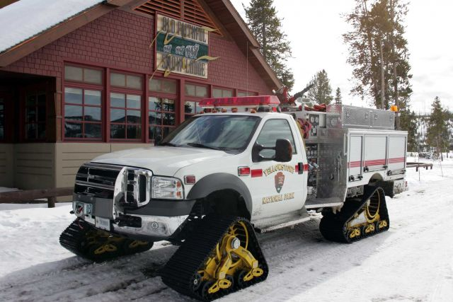 Fire engine equipped with Mattracks in front of Old Faithful Snow Lodge Picture