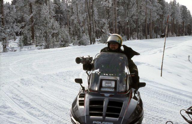 Ranger Bob Love using radar gun to time snowmobiler Picture