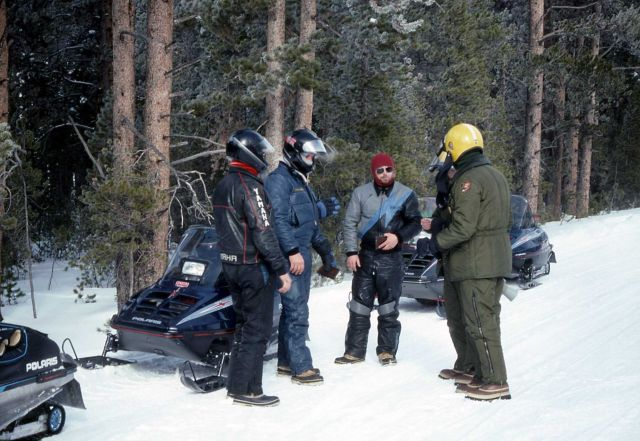 Ranger Bob Love with snowmobilers who were clocked at 70 mph Picture