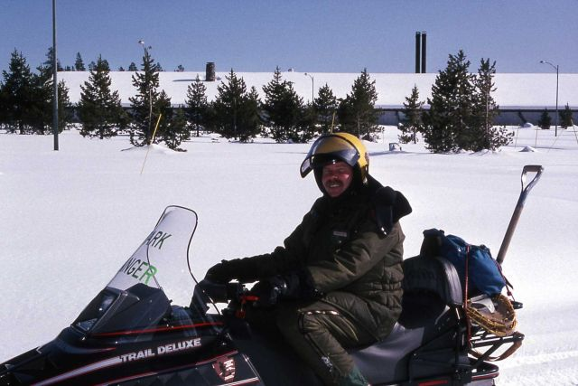 Ranger Bob Love on a snowmobile at Canyon Village Picture