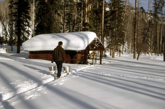 Ranger Brian Chan hauling water to the Upper Miller Creek cabin Picture