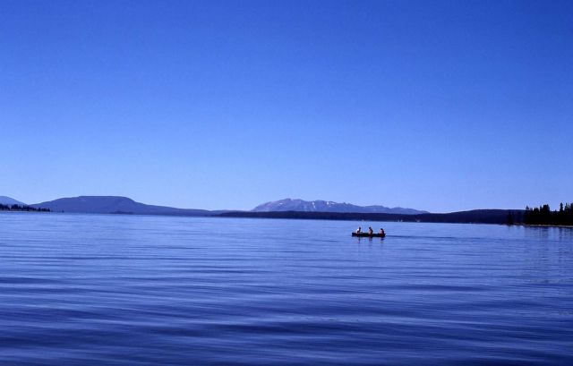 Boat on Yellowstone Lake with the Red Mountains in distance Picture