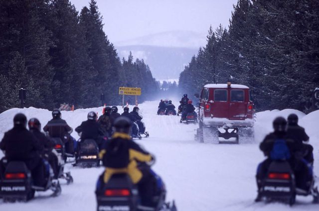 Snowmobiles & exhaust at West entrance in the winter on Presidents Day weekend Picture