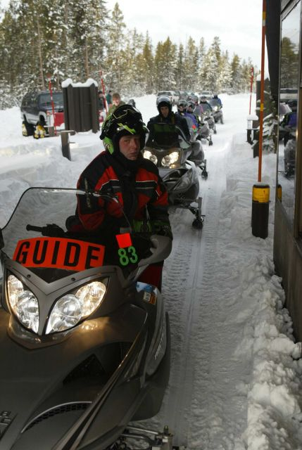 Snowmobile guide with group in the winter at the West entrance Picture