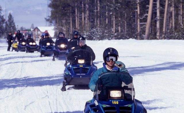 Snowmobiles lined up at West entrance in the winter Picture