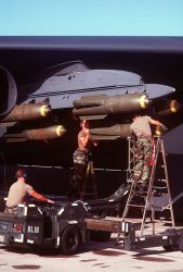 MJ-1 bomb loader - Ordnancemen load bombs on a B-52 Stratofortress aircraft Photo