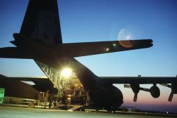C-130 Hercules transport aircraft being loaded Photo
