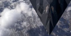 F-117A - High above the mountain top Photo