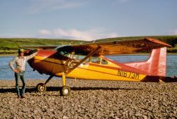 Small Airplane on River Gravel Photo