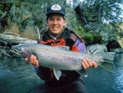 Brad Benter Holds a Rainbow Trout Photo
