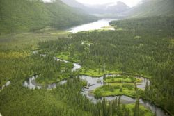 Meandering River Through Mountain Valley Photo