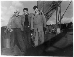 Three Servicemen on Boat Deck Photo