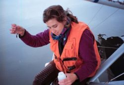 Shannon Nelson, USFWS Employee, Taking a Water Sample Photo