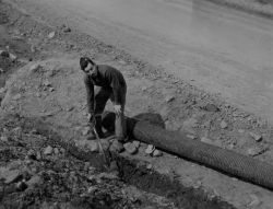 Serviceman Digging Trench Photo