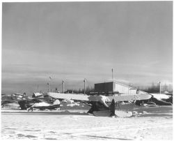 Small Airplanes at Airport in Winter Photo