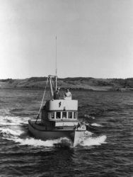 Frank Beals at Wheel of Patrol Boat in Kodiak Photo
