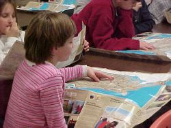 Girl Reads Refuge Visitor's Guide Photo