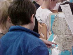 Boy Looks At Refuge Visitor's Map Photo