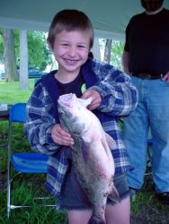 Boy Holding Big Fish Photo