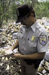 FWS Employee With Conch Shell Photo