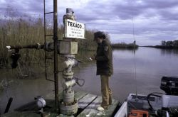 Checking Oil Well on Delta NWR Photo