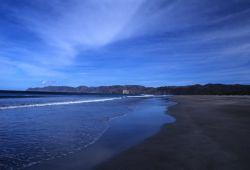 Calm Surf on Sandy Shore Photo