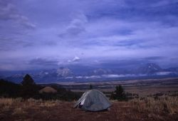 Tent in Front of Mountains, Plains, and Forest Photo