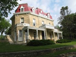 The Tallgrass Prairie Preserve headquarters building, a fine old ranch house built of locally quarried limestone Photo