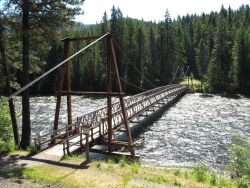 The Mocus Point suspension foot bridge into the Clearwater National Forest. Photo