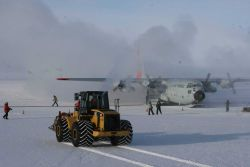 Bringing cargo to an Air Force C-130. Photo