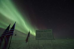 Starry starry night with aurora australis over the geographic South Pole. Photo