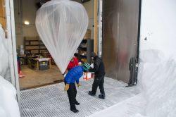 Launching an ozonesonde balloon. Photo