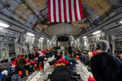Scientists leaving South Pole Station on C-17 Globemaster. Photo