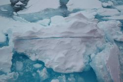 Sea-ice overturned by the moving icebreaker USCG Icebreaker HEALY during a NOAA-sponsored expedition to study the marine life of the Canada Basin. Photo
